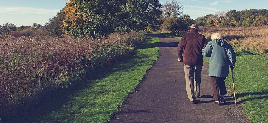 Old couple walking on path